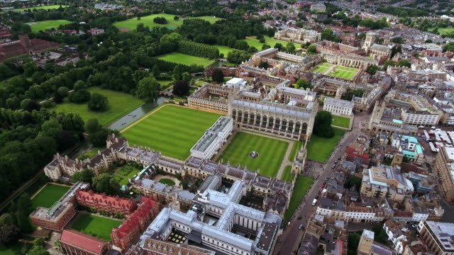 4K Aerial Stock Footage of Cambridge University UK 4K Aerial stock footage orbiting University of Cambridge with sunshine during summer England, United Kingdom campus stock videos & royalty-free footage