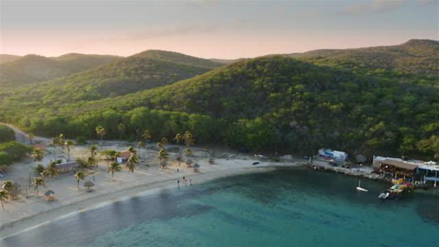 aerial sunrise view over a beach on the beautiful island of  Curacao - Caribbean Sea video