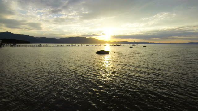 Aerial sunset fying over boat video