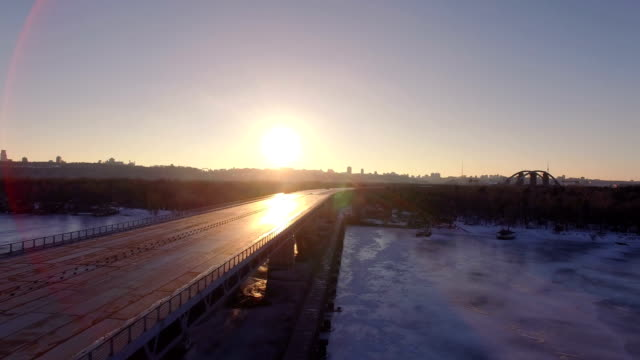 4K Aerial. Sunset over Unfinished empty highway, solar patches of light