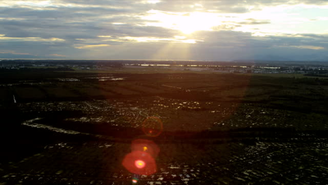 Aerial sunset view North Delta  peat bog, Vancouver Aerial sunset view North Delta Nature Reserve peat bog or Burns Bog nr South Arm of the Fraser River, nr Annacis Highway, Vancouver, Canada fraser river stock videos & royalty-free footage