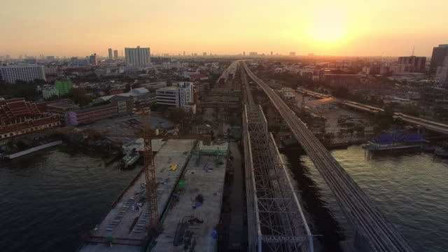 aerial sunset view shot of bridge construction site - fiume chao phraya video stock e b–roll