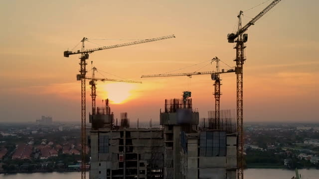 aerial sunset view shot of construction site - acciaio video stock e b–roll
