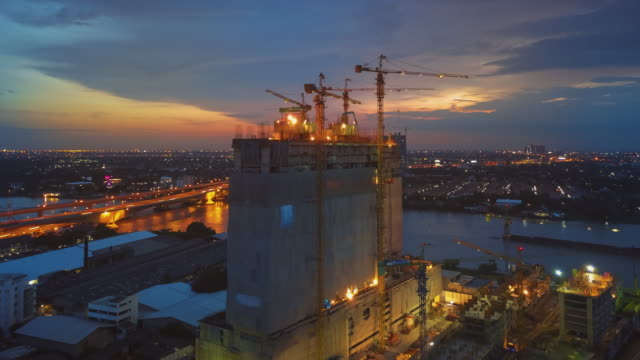 Aerial Sunset View shot of Construction Site,Hyper lapse Aerial Sunset View shot of Construction Site,Hyper lapse concrete architecture stock videos & royalty-free footage