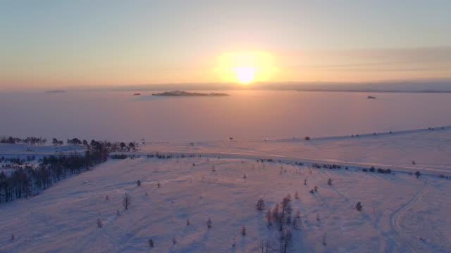 vídeos de stock e filmes b-roll de aerial survey from the air. winter. lake baikal. small sea - lago baikal