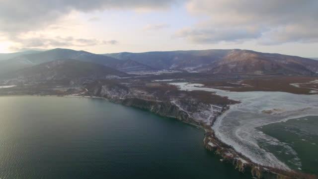 vídeos de stock e filmes b-roll de aerial survey from the air. winter. lake baikal - lago baikal