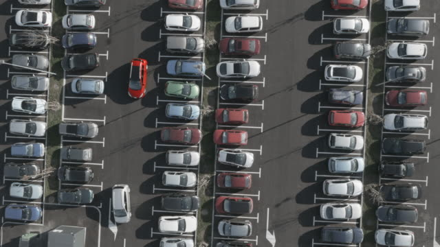 4K Aerial: Switching Cars on Parking Lot video