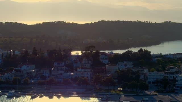 Aerial - telephoto lens - flying backwards above a small harbor at dusk - Porto Heli - Porto Cheli - Greece - Argolis - Argolida video