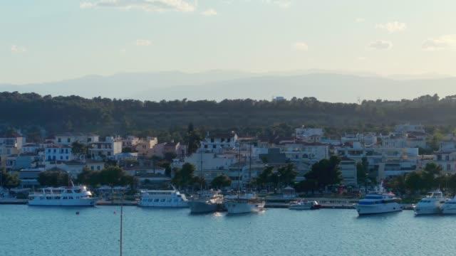 Aerial - telephoto lens - flying forward above a small harbor at dusk - Porto Heli - Porto Cheli - Greece - Argolis - Argolida video