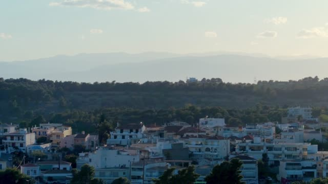 Aerial - telephoto lens - flying upwards above a small harbor at dusk - Porto Heli - Porto Cheli - Greece - Argolis - Argolida video