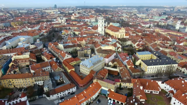 aerial: the old town of vilnius at spring time - lituania video stock e b–roll