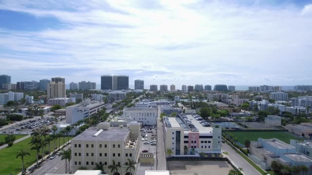 Aerial tilt up shot showing buildings in Miami, Florida Tilt up and Pan aerial shot of Miami, Florida around neighborhood south stock videos & royalty-free footage