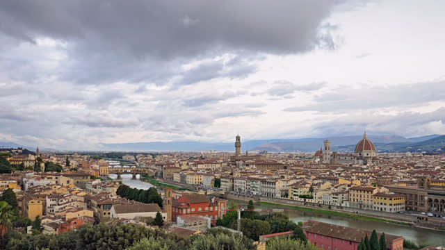 Aerial time lapse Florence old town and Ponte Vecchio bridge over of Arno river, view from Piazzale Michelangelo in Florence, Italy.