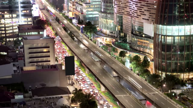 Aerial time lapse of busy car traffic in Jakarta High angle time lapse of car traffic jam during peak hour in Jakarta, Indonesia jakarta stock videos & royalty-free footage