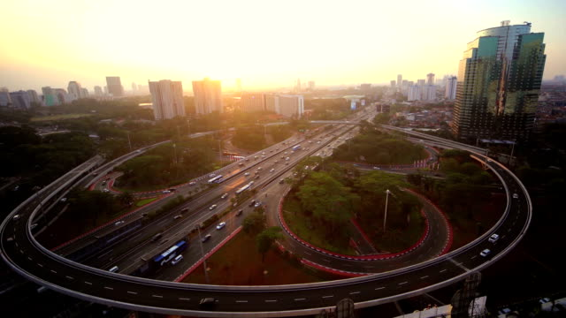 Aerial time lapse of cars moving by at Semanggi Junction in Jakarta, Indonesia Time lapse of car lights moving at Semanggi Intersection in jakarta, Indonesia jakarta stock videos & royalty-free footage