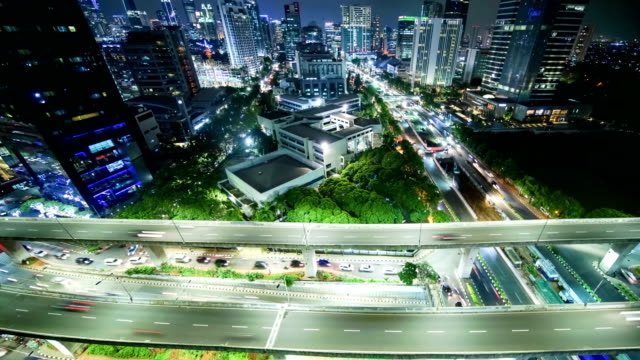 Aerial time lapse of highway intersection at night Aerial time lapse of Kuningan highway  intersection shot from rooftop indonesia stock videos & royalty-free footage
