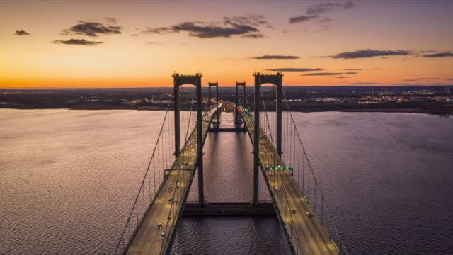 Aerial timelapse of Delaware Memorial Bridge at dusk. Aerial timelapse of Delaware Memorial Bridge at dusk. The Delaware Memorial Bridge is a set of twin suspension bridges crossing the Delaware River between the states of Delaware and New Jersey traffic time lapse stock videos & royalty-free footage