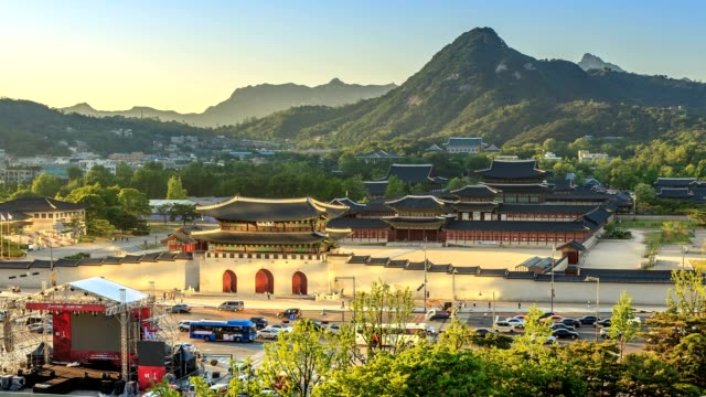 Aerial time-lapse of Gyeongbokgung palace and the Blue House from day to night, Seoul, South Korea Shot with Canon 5d4 gwanghwamun gate stock videos & royalty-free footage