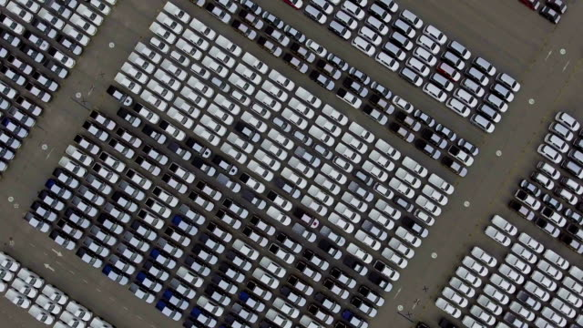 Aerial top down bird view of new car storage parking lot