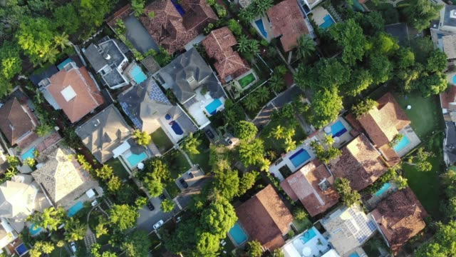 Aerial Top Down Dolly View Of upscale residential houses in Barra da Tijuca on a summer day video