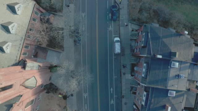 aerial top down drone shot flying parallellt med quiet road i suburban boston - massachusetts bildbanksvideor och videomaterial från bakom kulisserna
