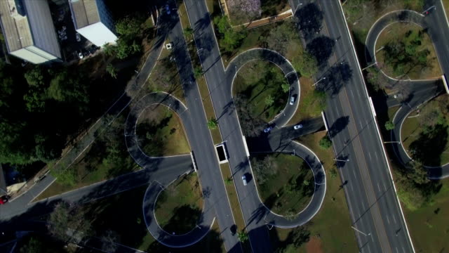 Aerial top down rotating above intersecting roads in Brasilia video