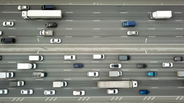 Aerial Top Down View of Traffic Jam on a Highway Aerial view of a wide highway with moving vehicles, shooting from the quadcopter in motion directly above stock videos & royalty-free footage