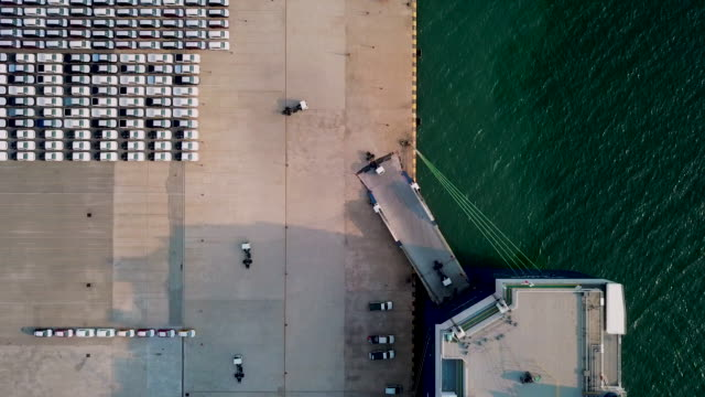 Aerial top view Car or Vehicle carrier vessel loading car for shipping to worldwide.
