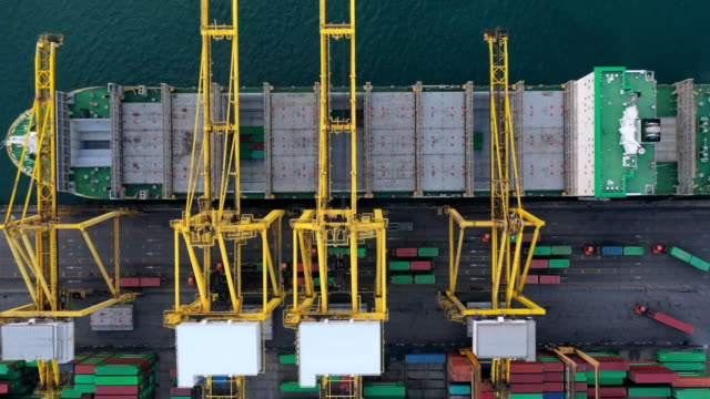 aerial top view container cargo ship in import export business logistic and transportation of international by container cargo ship in the open sea, time lapse aerial view. - rotterdam video stock e b–roll