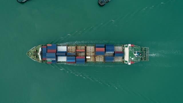 vídeos de stock e filmes b-roll de aerial top view container ship on the sea for logistics shipping, import export or transportation. - transatlântico