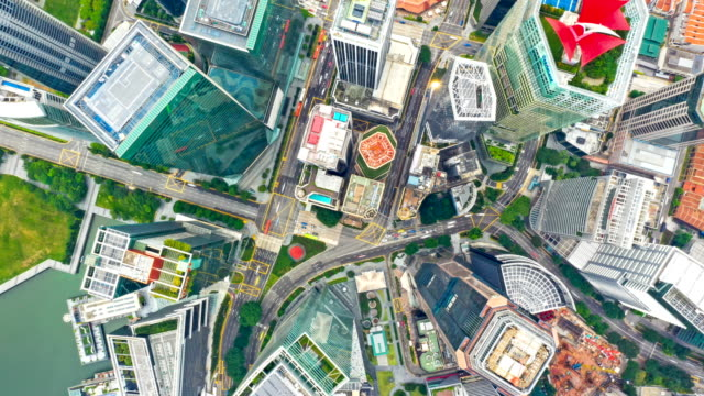 Aerial Top View drone-lapse or time-lapse of financial central business district building of Singapore city at Day
