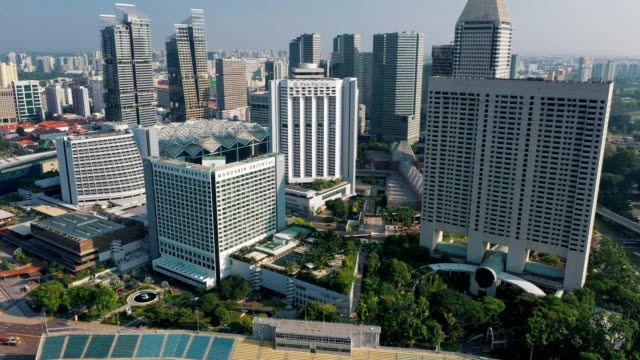 aerial top view of financial central business district building of singapore city at day - singapore architecture stock videos & royalty-free footage