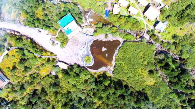 Aerial Top View of Lake and Dwelling House on Tropical Mountain with Moving Cloud, Guizhou Province, China video