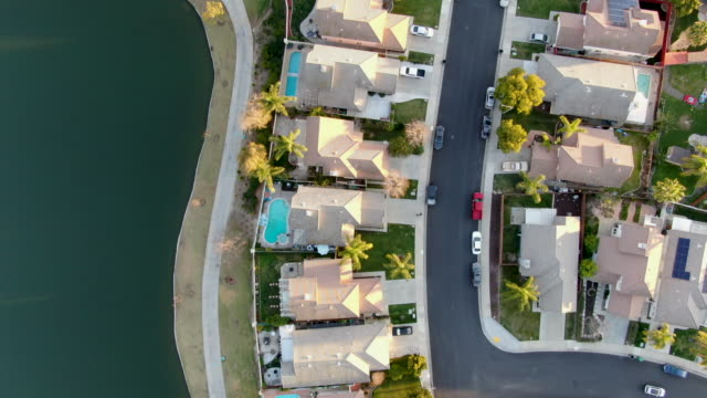 Aerial top view of Menifee Lake and neighborhood, residential subdivision vila during sunset