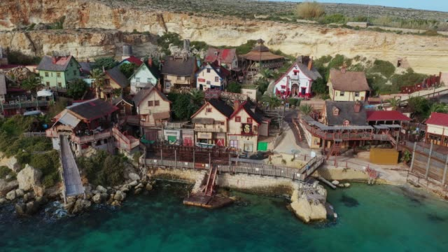 Aerial top view of Popeye Village. Sunny day, blue sea, blue sky. Mellieha city. Europe. Malta country Aerial top view of Popeye Village. Sunny day, blue sea, blue sky. Mellieha city. Europe. Malta country malta stock videos & royalty-free footage