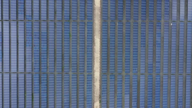 Aerial Top view of solar panels energy plant. Alternative energy from nature video