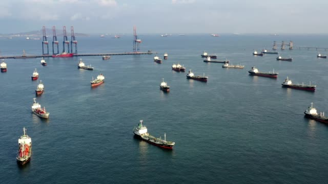 Aerial top view oil tanker ship from refinery bridge for transportation on the sea. Aerial top view oil tanker ship from refinery bridge for transportation on the sea in south east asia incomplete stock videos & royalty-free footage