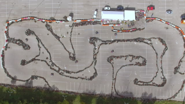 Aerial top-down view of a karting track with racing karts