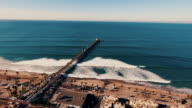 istock Aerial tracking shot of a beautiful sunrise sparkling off the ocean as the pier is revealed. 494779708