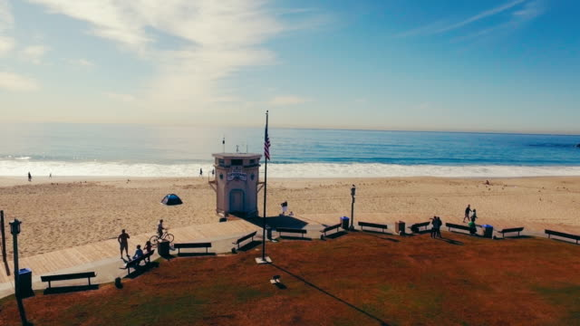 Aerial tracking shot of a lifeguard station in Southern California's Laguna Beach. video