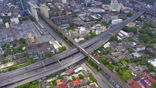 Aerial traffic Turnpike Highway with urban scene over cityscape video