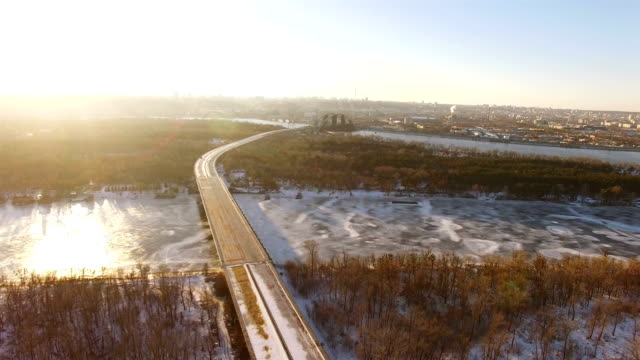 4K Aerial. Unfinished abandoned highway in city winter suburb. Urban landscape