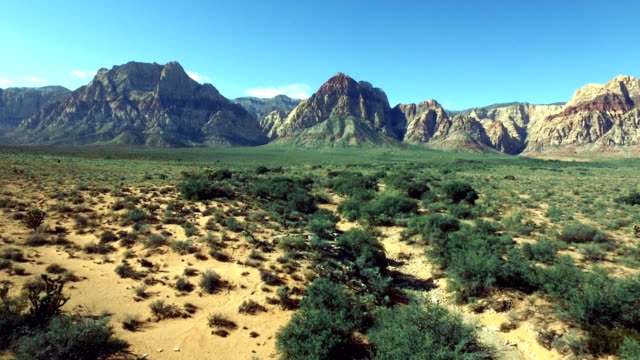 aerial vertical pan and track of red rock canyon in nevada. - parco statale del red rock canyon video stock e b–roll