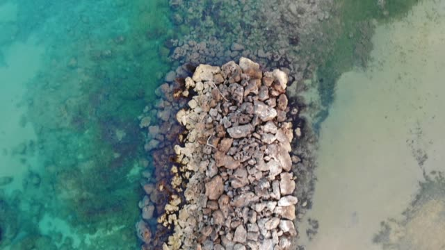Aerial vertical view at sunrise of the Cirica Bay, Italy, 4K