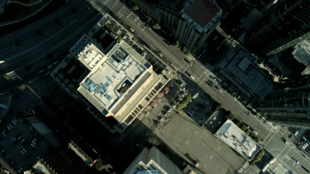Aerial vertical view of rooftop city buildings, USA video
