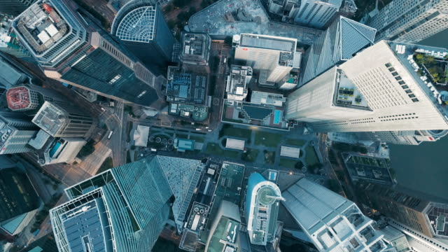 Aerial vertical view of rooftop financial district buildings, Singapore video
