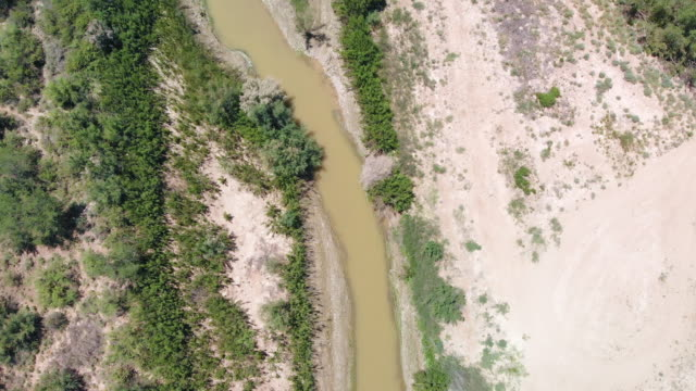 Aerial Video Clip Of The Border With Mexico, The Rio Grande River, Without A Border Wall, Near El Paso, Texas Video Clip Of The Rio Grande River running between Mexico and Texas, USA, near El Paso Texas, without a border wall fort stock videos & royalty-free footage