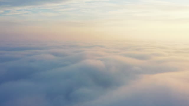 Aerial video dawn over the clouds drone shot
