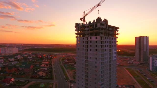 Aerial video footage of construction cranes at construction site video