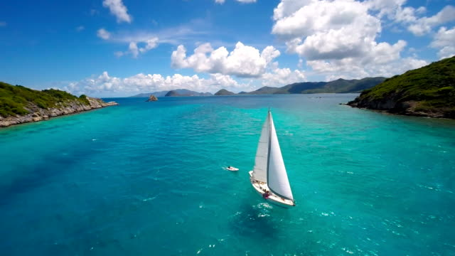 aerial video of a luxury sailboat traveling in the Caribbean video